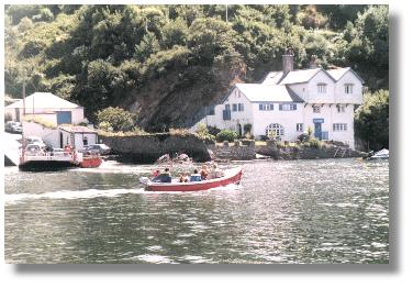 The Bodinnick to Fowey  car  ferry on the left and on the right the former home of author Daphne du Maurier. Photo: R.J.Tarr © 2001