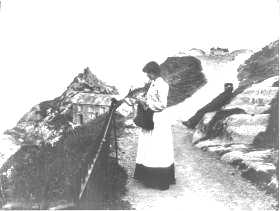 photo of Polperro woman knitting knit-frock