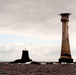The Eddystone lighthouse with the stump of Smeaton's tower to the left - copyright Sue Davis 2004